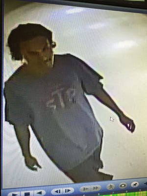 Surveillance camera photo of one of the suspects who broke into the University of Guam