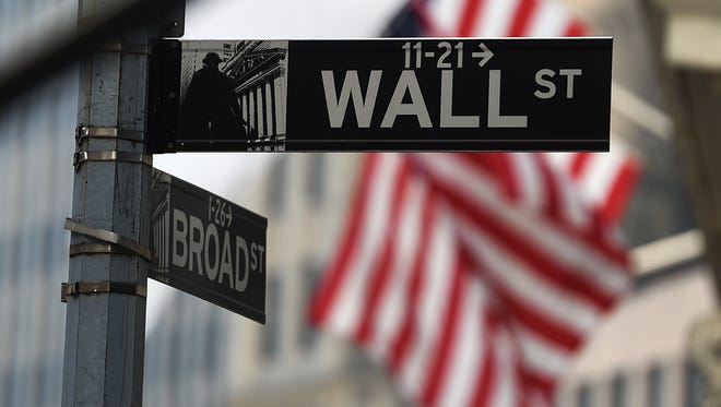 Wall Street road sign  near the New York Stock Exchange (NYSE) building in New York.