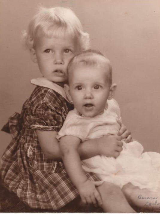635944390499575218-Deanna-holding-her-baby-sister-Emily---Courtesy-of-Cheryl-Kelley.jpg