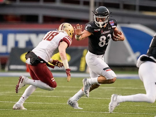 Jan 2, 2020; Birmingham, Alabama, USA; Cincinnati Bearcats tight end Josiah Deguara (83) pushes away Boston College Eagles defensive back Mike Palmer (18) at Legion Field. Mandatory Credit: Marvin Gentry-USA TODAY Sports