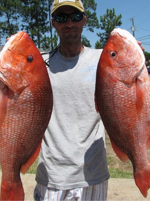 Local angler Dustin Service landed two huge red snapper last season while fishing out of his kayak.