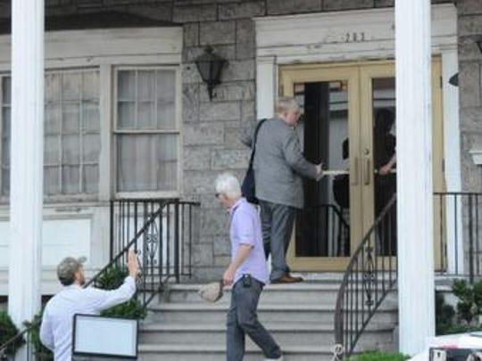 "Director John Slattery and Philip Seymour Hoffman prepare to shoot a scene in ""God's Pocket"" last summer. Slattery and his team shot key scenes in the film in and around Flower Funeral Home on New Main Street in Yonkers. It is the last film Hoffman completed before his Feb. 2 death"