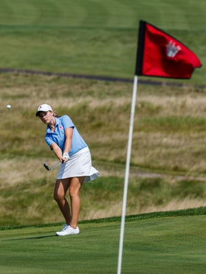 Arrowhead's Sarah Ernst chips onto a green during the 2017 Hartford Invitational at Washington County Golf Course on Thursday, Aug. 10.