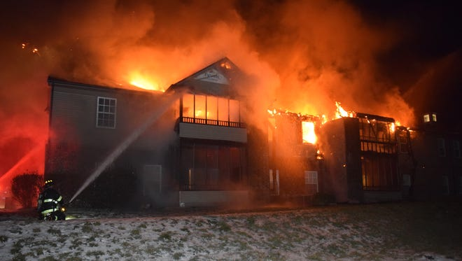 A fire at the Dakota Ridge Apartments off Banta Road on the south side displaced 16 residents on Saturday, Jan. 23, 2016.