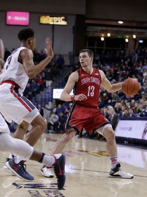 South Dakota guard Matt Mooney (13) dribbles the ball while defended by Gonzaga forward Johnathan Williams (3) during the second half of an NCAA college basketball game in Spokane, Wash., Wednesday, Dec. 21, 2016. (AP Photo/Young Kwak)