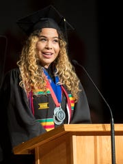 Southern Utah University graduate Ayleen Perry delivers the student graduation address during Commencement celebrations in the America First Event Center Friday, May 4, 2018.