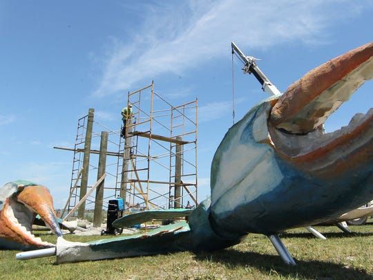 An effort is underway to restore Blue Crab, which was damaged during Hurricane Harvey. Parts of the Rockport, Texas landmark are seen in this 2012 photo with local artist David Allgood working on it.