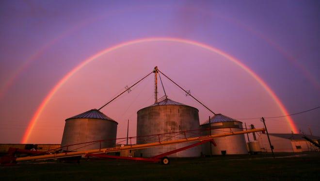 A sunset rainbow seen in Pleasantville, Ia., on Nov. 17, 2015, during a rain storm.