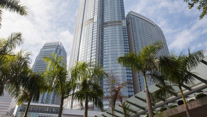 A view of the Four Seasons Hotel (right) and adjoining luxury serviced apartment complex Four Seasons Place (center) in Hong Kong where, according to reports, Chinese-born billionaire Xiao Jianhua was abducted by unknown persons on Jan. 27, 2017.
