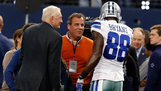 New Jersey governor Chris Christie (center) greets Dallas Cowboys wide receiver Dez Bryant (88) and owner Jerry Jones prior to the NFC Wild Card Playoff Game against the Detroit Lions at AT&T Stadium on Sunday.