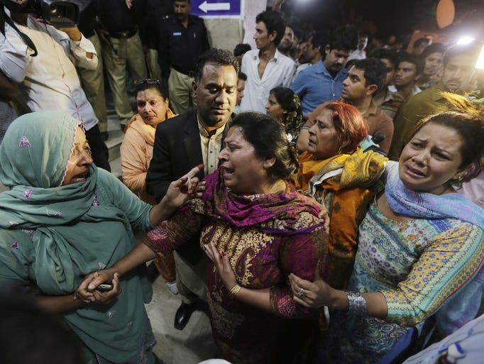 Relatives of the victims of a suicide bomb blast cry