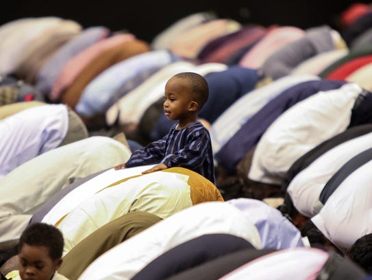 Ahmad Cabbie, 2, of Wilmington, rest his hands on the