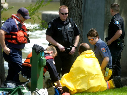Sioux Falls fire rescue personnel check over a man