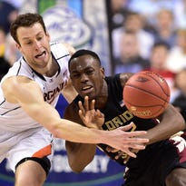 Virginia forward Evan Nolte (11) and Florida State guard Montay Brandon (32) fight for the ball in the second half of Thursday's ACC Tournament game.