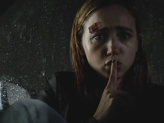 "Taking refuge in their wrecked car during a rainstorm, a mother (Zoe Kazan) warns her daughter to ""be vewwy, vewwy quiet"" so ""The Monster"" won't hear them."