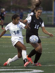 Jasmine Colbert of Freehold Township (14), fights for