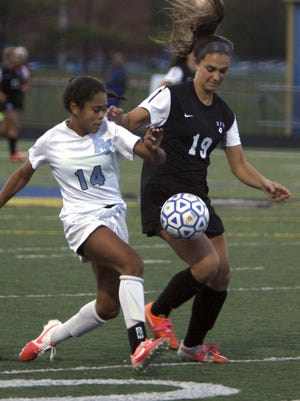 Jasmine Colbert of Freehold Township (14), fights for control with Rumson-Fair Haven's Michaela Borneo (19) in the SCT Semifinal on October 29, 2015.