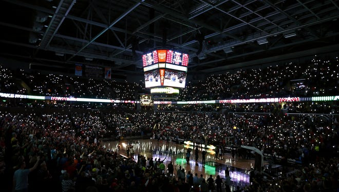 Attendees to the Bass Pro Tournament of Champions use their cellphones to light up the JQH Arena prior to the start of the championship final during the 2016 Tournament of Champions at JQH Arena.