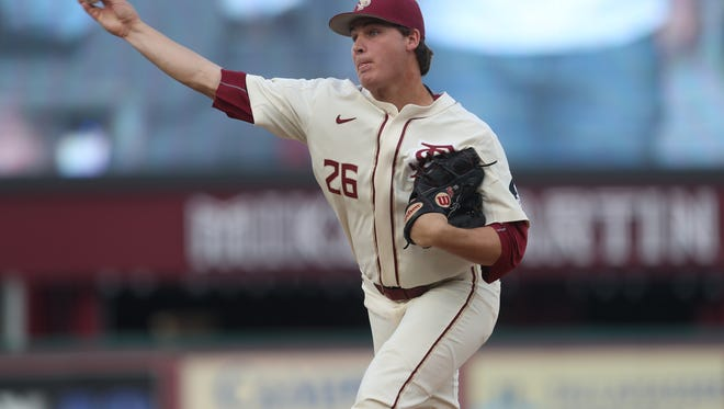FSU's Cole Sands pitches against Notre Dame during the Seminoles' 8-7 loss at Dick Howser Stadium on Friday, March 16, 2018.
