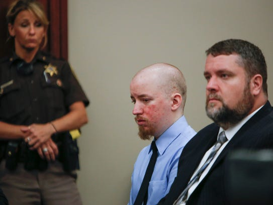 Thomas McClellan, center, sits with his attorney Patrick