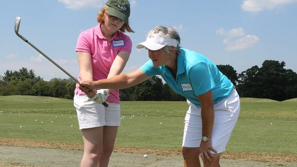 Brooke Remsen of Rye gets some pointers from pro Monique Thoresz during the WMGA Foundation's Girls to the Tee event at the Westchester Country Club in Rye Aug. 3, 2015. The event offers a free clinic that provides instruction and interaction for girls interested in golf. Thoresz is the director of golf instruction at the Apawanis Club in Rye.