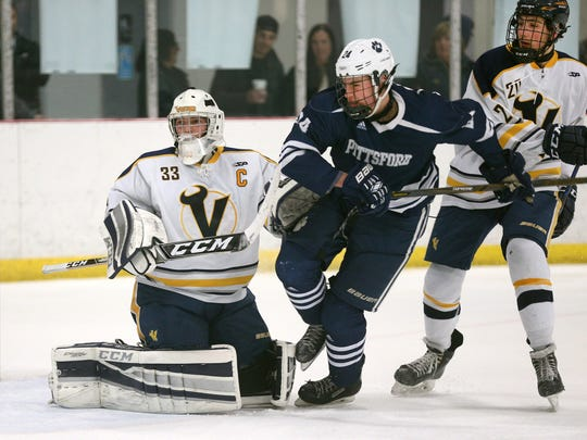 Victor goalie Chayse Ierlan tries to clear Pittsford's