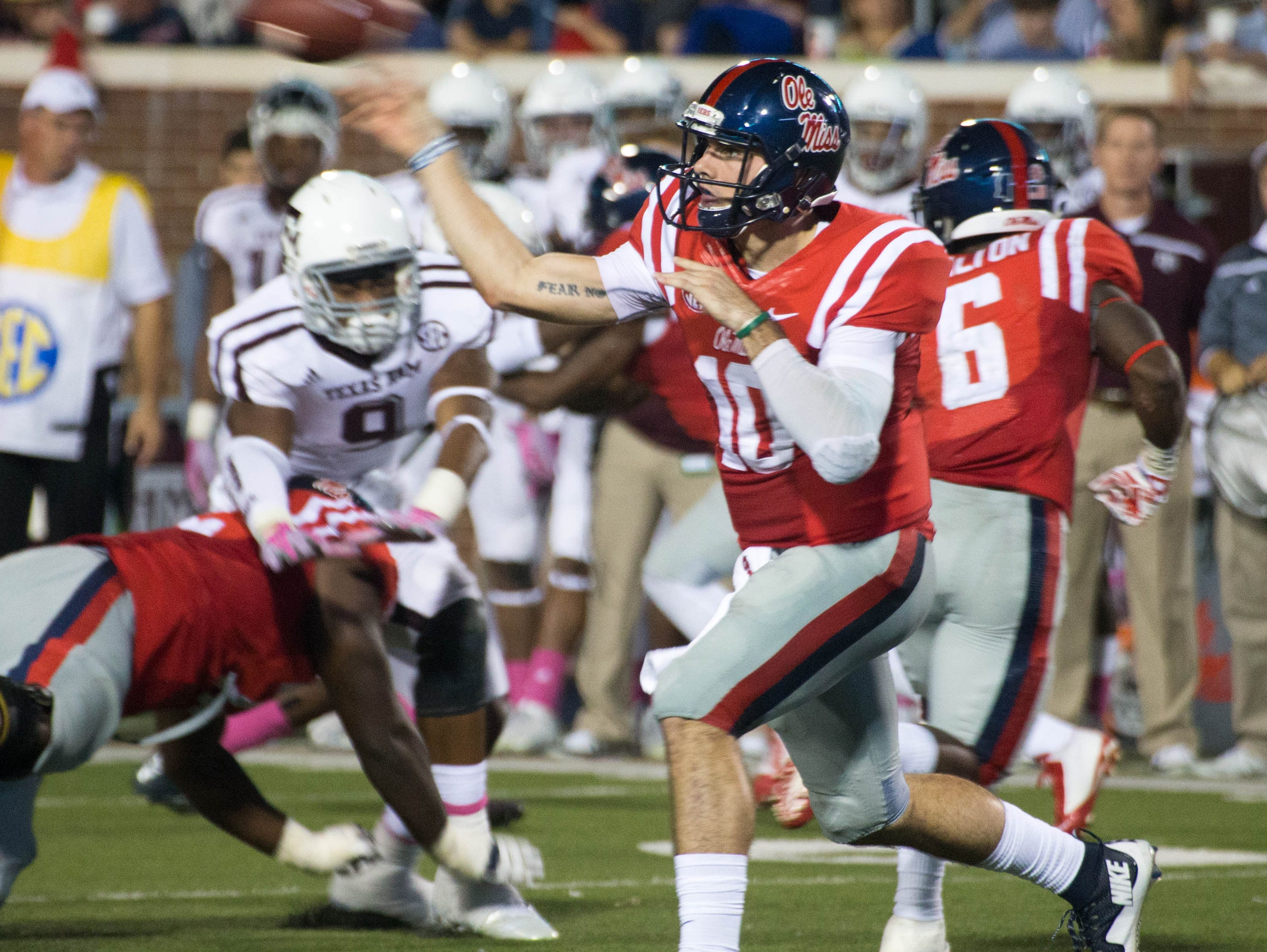 Chad Kelly throws the ball in the first half