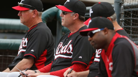 Reds manager Bryan Price, center, and coaches watch the action during a game earlier this month.