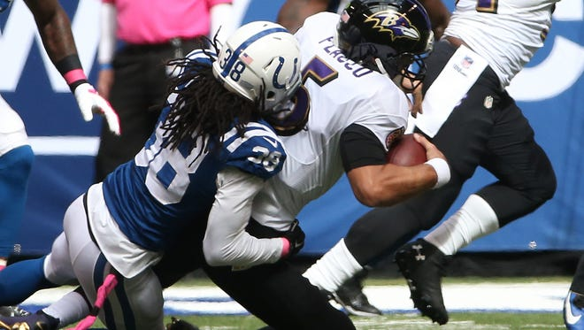 Indianapolis Colts Sergio Brown pulls down Baltimore Ravens Joe Flacco on a big fourth down play in the red zone in the second quarter. Indianapolis hosted Baltimore at Lucas Oil Stadium Sunday, October 5, 2014.