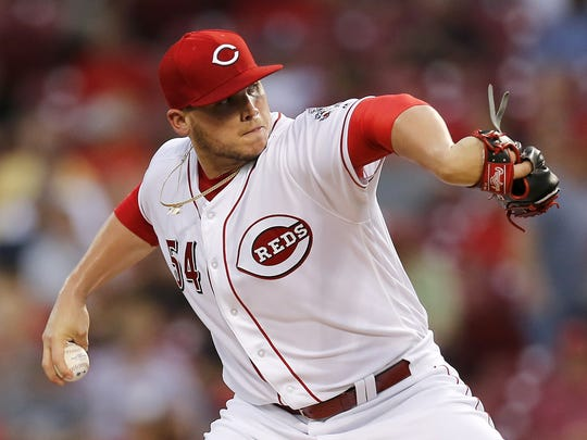 Cincinnati Reds starting pitcher Rookie Davis (54)