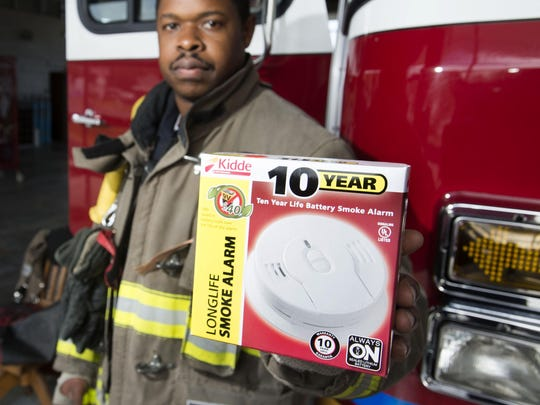 Escambia County Firefighter, Otis Evan, shows off one of the free smoke detectors available to local residents by calling 850-595-Hero (595-4376). 42-percent of the fires Escambia County Fire Rescue responded to in 2015 was at homes without working smoke detectors.