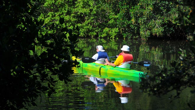 Helen and Karyl Bohnsack, from Iowa, paddle out into the Banana River from Ramp Road Park for a tour of the Thousand Islands.