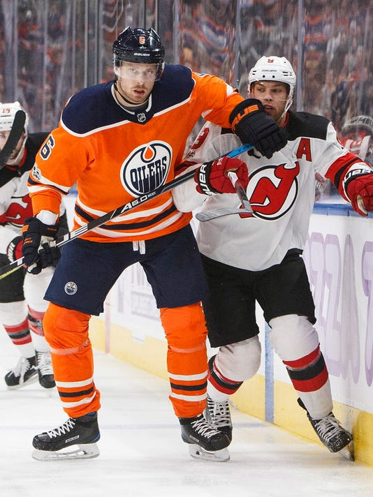 Taylor Hall, Adam Larsson