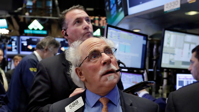 Traders Peter Tuchman, foreground, and Jonathan Corpina, background, work on the floor of the New York Stock Exchange, Thursday, Oct. 27, 2016.