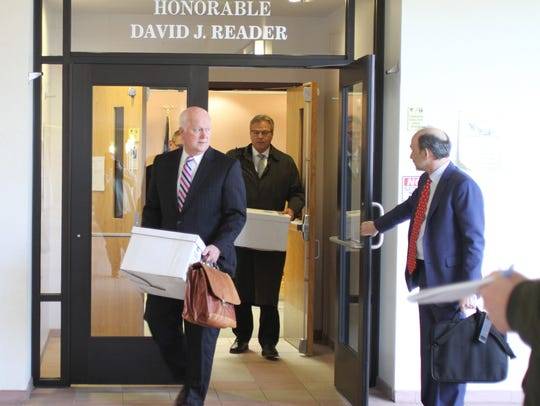 Southfield attorney Marc Lipton holds open the courtroom