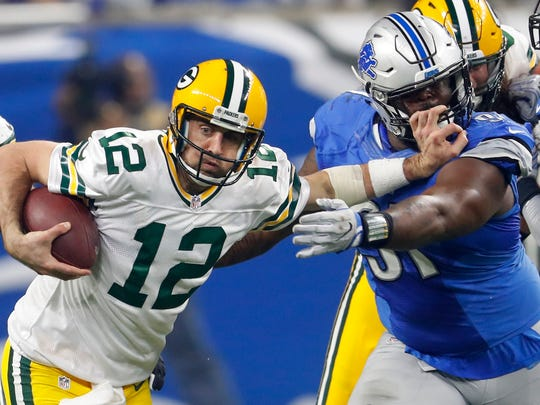 Packers quarterback Aaron Rodgers stiff-arms Lions defensive tackle A'Shawn Robinson on Jan. 1, 2017. Green Bay won, 31-24, to win the NFC North.
