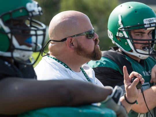Parkside Head Coach Brendan Riley talks to players during practice on Tuesday, Aug. 22, 2017.