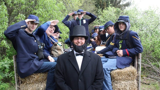 D.C. Everest Junior High Principal Jason McFarlane (as Abraham Lincoln) spends time with an eighth-grade Civil War regiment.
