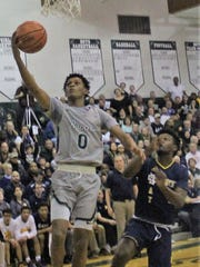 New Haven's junior guard Ronald Jeffery (0) soars in for a fast-break lay-up against Country Day Wednesday en route to the Class B regional title.