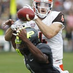 Leroy Clark breaks up a pass intended for Bowling Green's Gehrig Dieter Saturday, September 26, 2015, at Ross-Ade Stadium. Bowling Green defeated Purdue 35-28.
