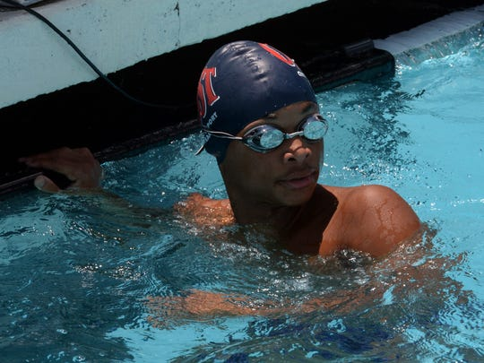 Brandon Seymour of COSST checks his time after swimming in the Boys 50M freestyle during the Calumet Specialty Damon McCoy Swim Invitational.