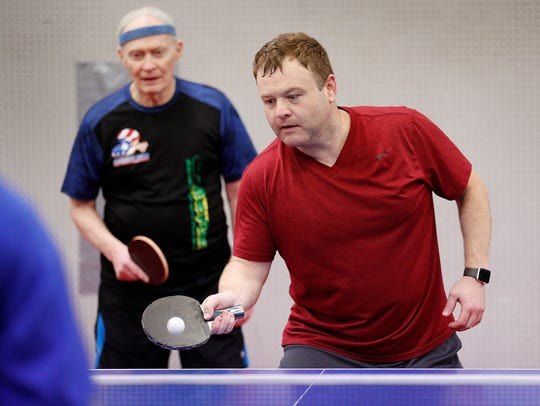 Frank Caliendo is also a table tennis enthusiast and a member of USA Table Tennis. Here he is playing double with Richard Hicks at the Table Tennis Club of Indianapolis on East Washington Street on Wednesday, April 11, 2018.