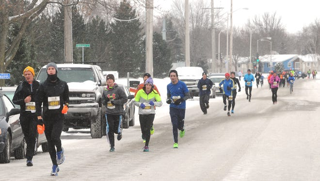Runners dressed for cold weather in Festival Foods annual Turkey Trot.