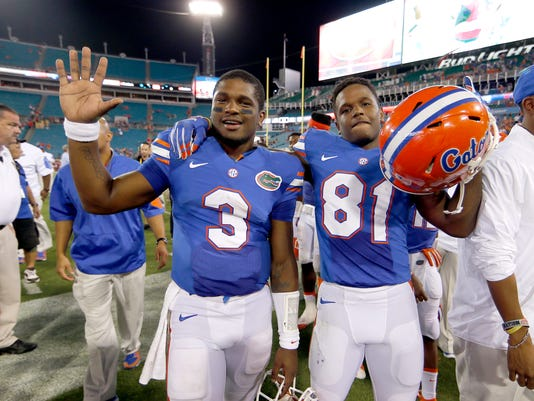 FILE - In this Oct. 31, 2015, file photo, Florida quarterback Treon Harris (3) and wide receiver Antonio Callaway (81) walk off the field together following an NCAA college football game against Georgia in Jacksonville, Fla. Florida coach Jim McElwain said Tuesday, March 8, 2016, that Harris and Callaway haven't been with the team since January, but he stopped short of saying they are suspended, as the Gators open spring practice on Wednesday. (AP Photo/Stephen B. Morton, File)