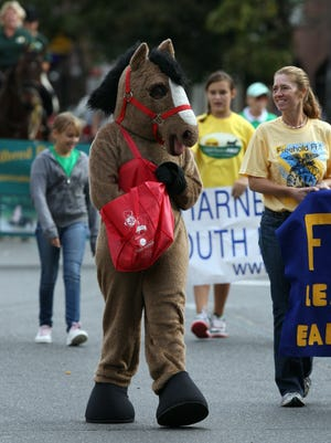 """A person in costume dressed as a horse marches in the """"Parade of Horses"""" in 2012 in Freehold Borough, part of the all day Open Space Pace event at Freehold Raceway where proceeds will benefit non-profit organizations that support the preservation of open space.  Jody Somers / For the Asbury Park Press"""