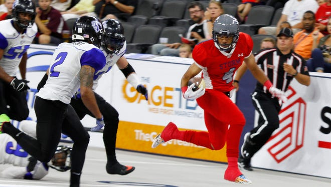 Sioux Falls Storm receiver Brandon Johnson-Farrell eyes a set of Cedar Rapids Titans defenders as he dashes up the field.