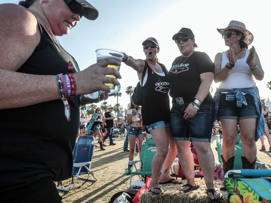 Apr 27, 2018; Indio, CA, USA; (from the left) Route 91 Harvest festival shooting survivors Patty Flemming, of Yorba Linda, Sue Heili, of Foothill Rancho, Connie Long, of Riverside, and Connie Long's emotional support helper Herlinda Bergman dance during the Stagecoach Country Music Festival at Empire Polo Club. About 600 survivors attended Stagecoach as a group. Mandatory Credit: Richard Lui/The Desert Sun via USA TODAY NETWORK