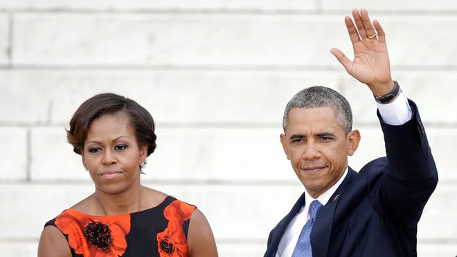 President Obama and first lady Michelle Obama commemorate the 50th anniversary of the March on Washington at the Lincoln Memorial on Wednesday.