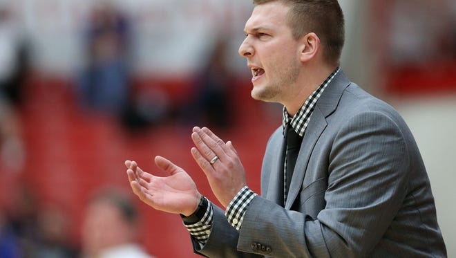 Center Grove head coach Zach Hahn encourages his team against Mooresville during Tuesday night's game held at Center Grove High School on Feb. 17, 2015. Center Grove beat Mooresville 71-56.