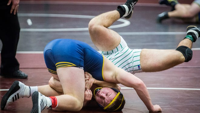 Delta's Jacob Bell faces off against Yortkown's Aidan Vernon at Wes-Del High School during the county wrestling tournament Thursday, Jan. 5, 2017.